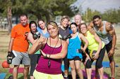 stock photo of boot camp  - Boot camp fitness instructor with group and thumbs up - JPG