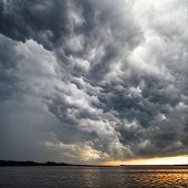 View Of Thunderstorm Clouds Above Water
