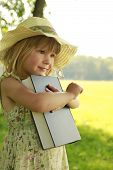 Beautiful Little Girl With The Bible In Nature