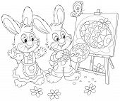 stock photo of cony  - Little rabbits drawing a decorated Easter egg on a canvas - JPG