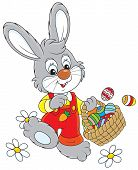 picture of cony  - Little rabbit walking with a basket of colorfully painted Easter eggs - JPG