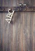 ABC Alphabet letters hanging on hook with farmyard cow toys
