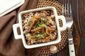 stock photo of buckwheat  - Buckwheat porridge with mushrooms in a bowl - JPG