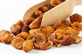 detail of naturally dried figs with measuring spoon