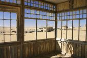 View Of Deserted Houses Through Window