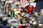 stock photo of flea  - precious antique furnishings and retro ceramic plates for sale vintage shop