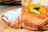Roll from flaky pastry with a fruit