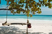 pic of seesaw  - horizontal photo with seesaw and beauty ocean white sandy beach - JPG