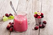 picture of curd  - Cranberry curd with fresh cranberries in a jar - JPG