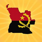 Angola map flag on sunburst illustration