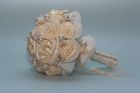 foto of homogeneous  - wedding bouquet on a homogeneous background artificial flowers - JPG