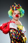 Funny clown with box gloves