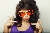 young funny woman with big orange sunglasses