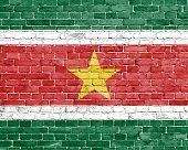image of suriname  - Grunge Surinam flag on white brick wall - JPG