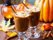stock photo of whipping  - Pumpkin spice coffee with whipped cream and caramel - JPG