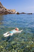 little girl snorkeling in Mediterranean Sea, France