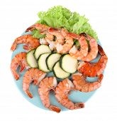 Fresh boiled prawns with avocado and lettuce in a blue round plate on white background isolated