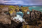 Londrangar Basalt Cliffs and the natural arch in Iceland
