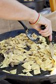 foto of porcini  - Chef cooks Ravioli pasta with porcini mushrooms - JPG
