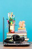 School Accessories On Desktop With Blank Blue Background