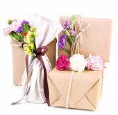 Beautiful gifts with flowers, isolated on white