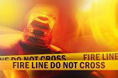 foto of flashing  - Fire Line Do Not Cross Yellow Headband Tape and Orange flashing and revolving light - JPG