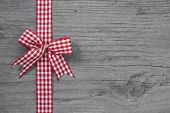 Top View Of Red And White Checked Ribbon Decoration On Wooden Background For A Present