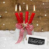 Merry Christmas In German Language With Four Red Candles For A Greeting Card