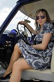 The girl behind the wheel of a retro car