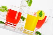 water and fruit juices with mint and ice