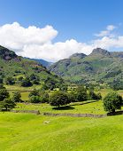 Langdale Valley Lake District Cumbria England UK in summer blue sky and clouds scenic beautiful