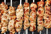 pic of kebab  - skewers with meat shish kebabs on brazier close up - JPG