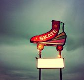 pic of skate  - a skating neon sign toned with a vintage retro instagram filter - JPG