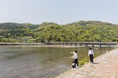 KYOTO, JAPAN - APRIL 26th  : Students throw stones at the shore of Hozu (Katsuragawa) River in Arash