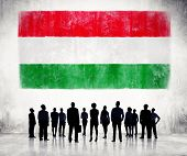 Silhouettes of Business People and a Flag of Hungary