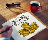 Businessman Drawing Money Concept on a Note Pad