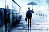 Depressed Businessman Standing While Holding an Umbrella