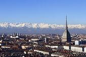 stock photo of turin  - Panoramic view of Turin with the Mole Antonelliana and snowy Alps in the background.