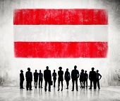Silhouettes of Business People and a Flag of Austria