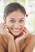 Beautiful brunette smiling at camera at the health spa