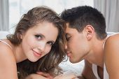 Close up side view of romantic young couple in bed at home