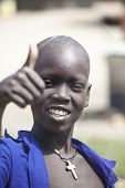BOR, SOUTH SUDAN-DECEMBER 2 2010: Unidentified Christian boy give the thumbs up. Christians were persecuted in South Sudan for decades