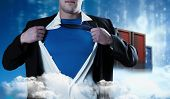 Businessman opening his shirt superhero style against cityscape on cloud
