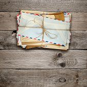 Bunch Of Old Envelopes On Wooden Background