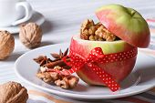Red Apple With Nuts And Raisins And Coffee On The Table