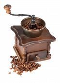 stock photo of wooden box from coffee mill  - Brown vintage coffee grinder with coffee beans on white background - JPG