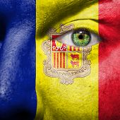 Flag Painted On Face With Green Eye To Show Andorra Support