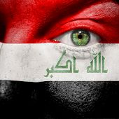Flag Painted On Face With Green Eye To Show Iraq Support