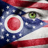 Flag Painted On Face With Green Eye To Show Ohio Support