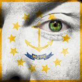 Flag Painted On Face With Green Eye To Show Rhode Island Support